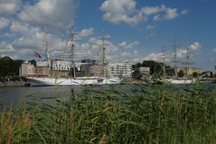 Sailing ships near embankment Royalty Free Stock Images