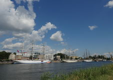 Sailing ships near embankment Royalty Free Stock Photo