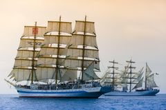 Sailing ships passing through sea. Competition concept. Common aim royalty free stock photos