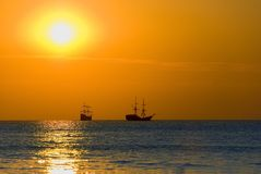 Sailing ships at sea. Two sailing ships at sea at sunset stock photography