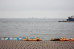 Sailing ships in the sea. Near Vladivostok city quay royalty free stock photography