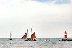 Sailing ships on the sea. Tall Ship and lighthouse Yachting travel. Stock Photos