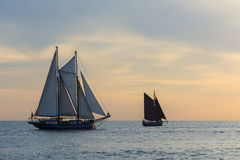 Sailing ships in sunset. Off Warnemunde during Hanse Sail 2014. Rostock, Mecklenburg-Vorpommern, Germany, Europe royalty free stock photos