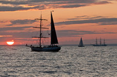 Sailing ships in Sunset. Sailing ship in sunset in the Bay of Finland Royalty Free Stock Images