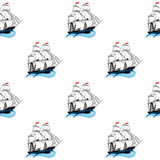 Sailing ships with white sails and red flags Stock Photo