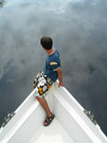 Sailing in the sky or sky diving. Sailing in the sky - boy on boat royalty free stock image