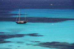 Sailing and snorkeling. In summer into the deep blue sea of Sardinia Royalty Free Stock Photos