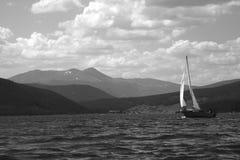 Sailing Solitude. Solitary sailboat on Lake Dillon, CO Royalty Free Stock Image
