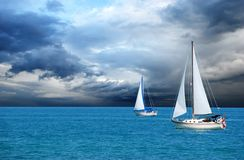 Sailing after a storm stock image