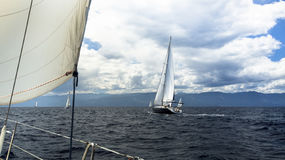 Sailing in stormy weather. Luxury boat on the sea. Royalty Free Stock Image