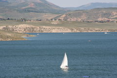 Sailing on Strawberry. Sail boat on Strawberry Reservoir, Utah Royalty Free Stock Images