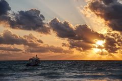 Sailing into the sun Stock Photography