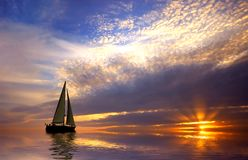 Sailing and sunset. Sailing with a beautiful sunset Royalty Free Stock Image