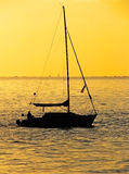 Sailing at sunset 2. Beautiful boat silhouette against a sunset sky Royalty Free Stock Photo