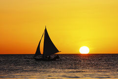 Sailing in sunset Stock Photography