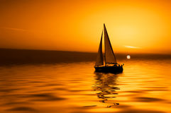 Sailing and sunset Royalty Free Stock Photography