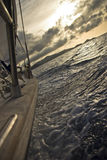 Sailing at sunset. Sailing in mediterranean sea, island Elba, at sunset Stock Photos