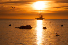 Sailing and sunset Stock Images
