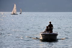 Sailing before sunset stock photography