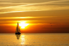Sailing at sunset Stock Photos