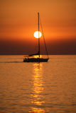 Sailing at sunset. Sailing during a fiery sunset Royalty Free Stock Photos