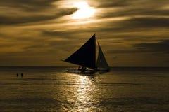 Sailing at Sunset. Sailing a banca boat at sunset in tropical paradise Royalty Free Stock Photos