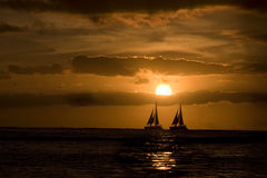 Sailing at sunset. Royalty Free Stock Image