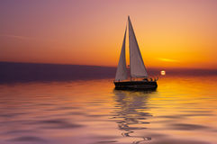Sailing and sunset stock photo