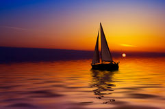 Sailing and sunset. Sailboat against a beautiful sunset Stock Photography