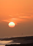 Sailing at sunset in Half Moon Bay. Sunset and silhouetted sailboat over Half Moon Bay, California Royalty Free Stock Image
