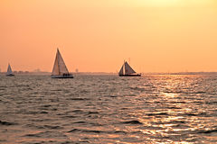 Sailing at sunset on the IJsselmeer in Netherlands. Sailing at sunset on the IJsselmeer in the Netherlands Royalty Free Stock Photos
