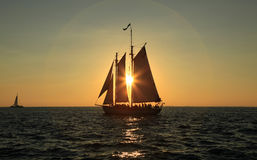 Sailing into the sunset Stock Images