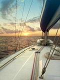 Sailing at sunset in the Mediterranean sea Royalty Free Stock Photos