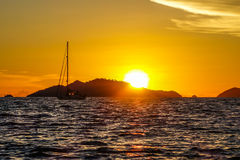 Sailing at sunset. Sailing in the ocean with beautiful sunset scenery on background stock photography