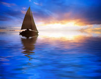 Sailing at sunset Stock Photo