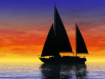 Sailing at sunset. Sailboat sailing on a calm sea at sunset Royalty Free Stock Photo