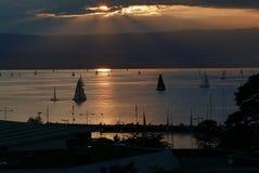 Sailing at sunset. On lake Geneva viewed from Evian-les-Bains royalty free stock photos
