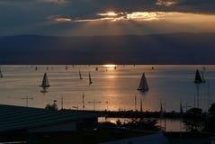 Sailing at sunset. On lake Geneva viewed from Evian-les-Bains royalty free stock photography