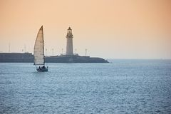 Sailing At Sunset. Sport background Stock Images