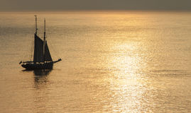 Sailing during a sunset. Royalty Free Stock Image