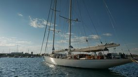 Sailing superyacht ketch moored in marina at stock video footage