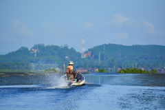 Sailing. A Thai fisherman working in the morning by driving the motor boat Royalty Free Stock Images
