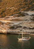 Sailing time. Sailing yachts near Bonifacio white cliffs Royalty Free Stock Photo