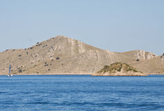 Sailing to Kornati archipelago. The Kornati archipelago is formed by a group of 89 islands far from the Dalmatian coast between Zadar and Sibenik. The landscape Royalty Free Stock Images