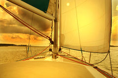 Sailing to the sunrise stock photography