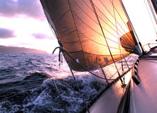 Sailing to the sunrise. During a regatta in Atlantic Ocean