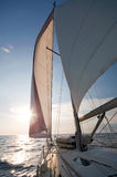 Sailing to the sunset royalty free stock photos