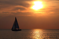 Sailing to sunset Stock Photo