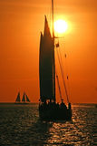 Sailing to the sunset. Sailing vessel at sunset Stock Photos