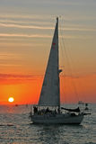 Sailing to the sunset. Sailing vessel at sunset Royalty Free Stock Photography